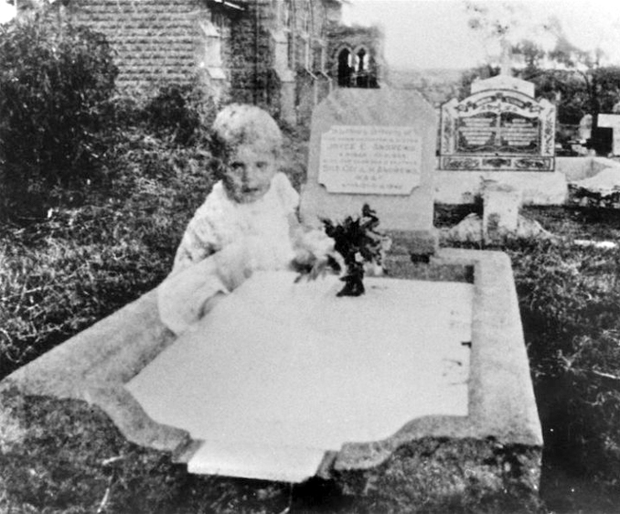 This creepy cemetery photo shows an alleged ghost baby sitting by a grave
