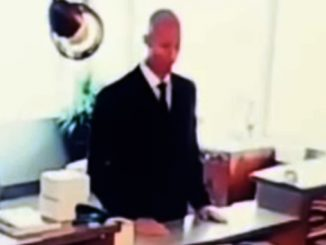 Footage of a men in black agent in an office, one of many scary videos.