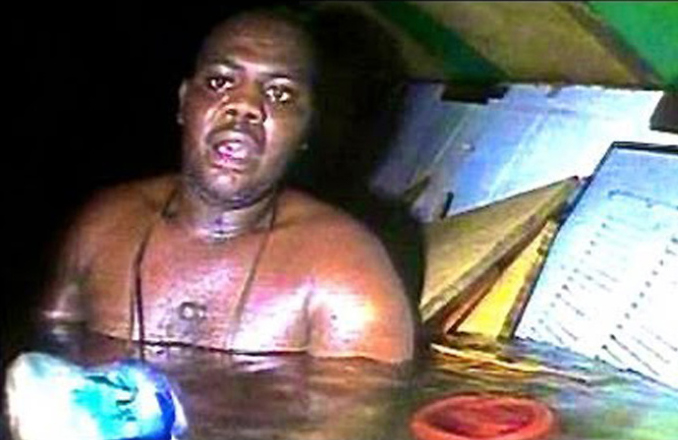 This real photo has a chilling backstory. Harrison Okene Survives underwater for 2 days.