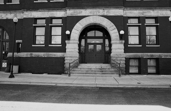 Black and white photo of the entrance to Maxwell Police station.