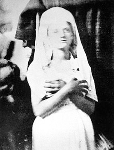 A black and white photo of the spirit of Katie King, one of the world's most famous paranormal mysteries.