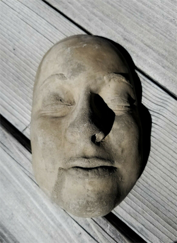 Antique Death Mask said to be cursed, available on eBay.