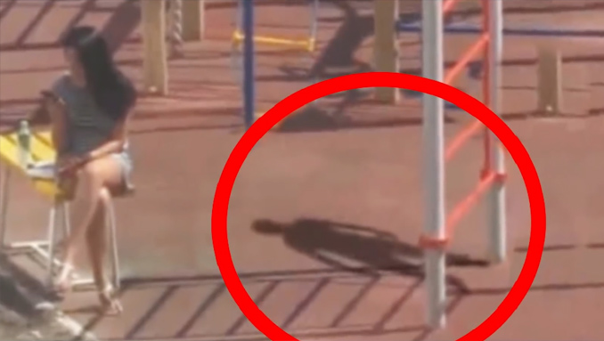 Mysterious shadow person filmed in children's playground.