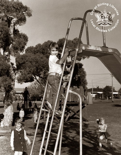 An old photo of Slender Man in a children's playground.