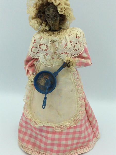 A doll with an old apple for a head, built circa 1970. Rumoured to be haunted.