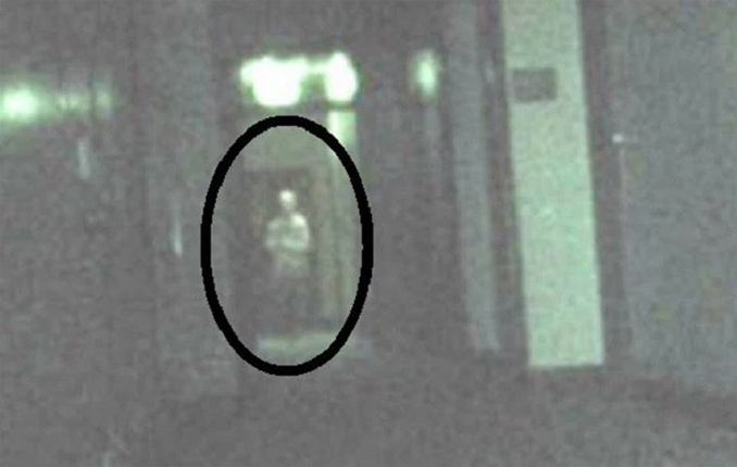 Strange figure photographed in asylum, alleged to be a paranormal photo.
