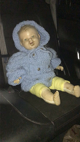 Male doll with blue jumper, is one of many haunted dolls available on eBay.