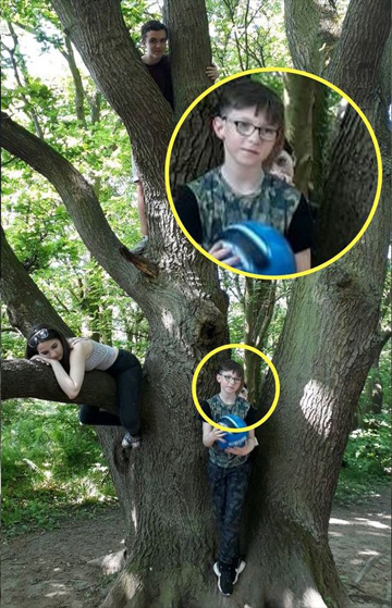 This unsettling photo shows a ghost child appearing in tree.