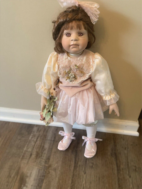 Dolls with red eyes called Laci, listed on eBay.