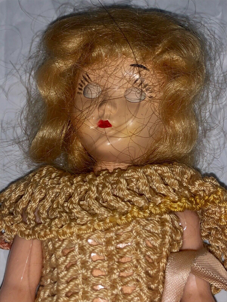Blonde haired doll with closed eyes called Sally. Reported to be haunted.