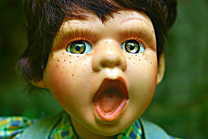 Doll with wide mouth, reported to be haunted by a demon known as Sar'Gomos
