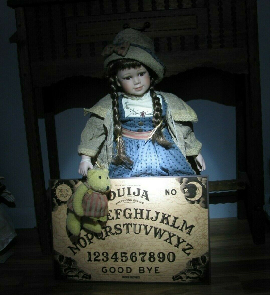 Doll named sheila with teddy bear and ouija board.