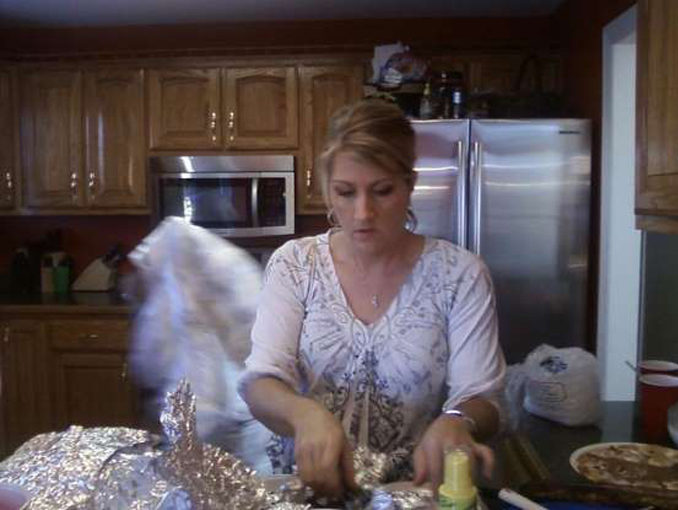 Lady in kitchen with white apparition in background