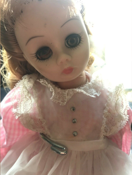 Wide-eyed doll listed on eBay is reported to be one of many haunted dolls on eBay.
