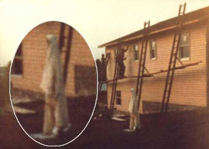 Famous ghost photo of woman in white.