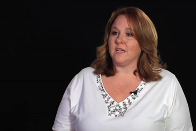 Photo of Debbie Cain with black background. Cain claims she's been to heaven.