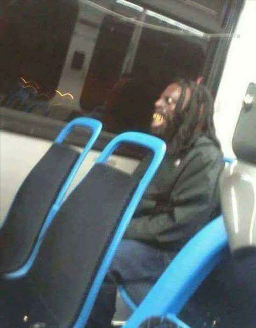 Scary man on a bus.