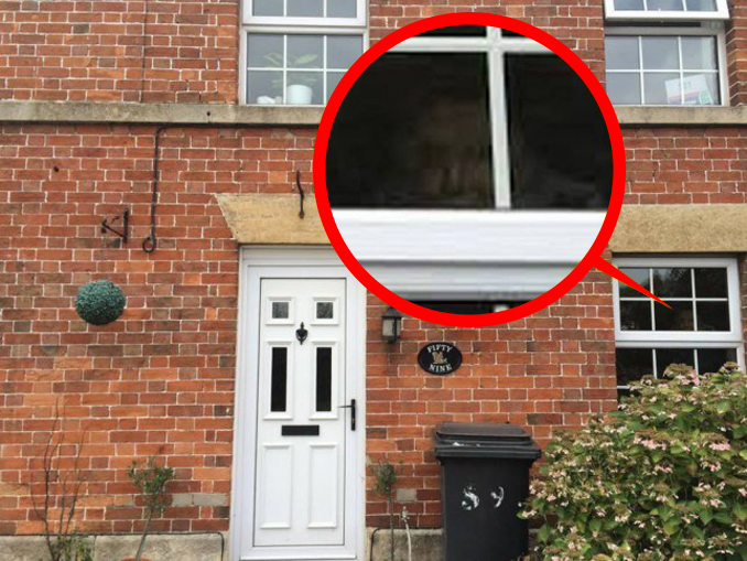 Photo of a ghost in a window.