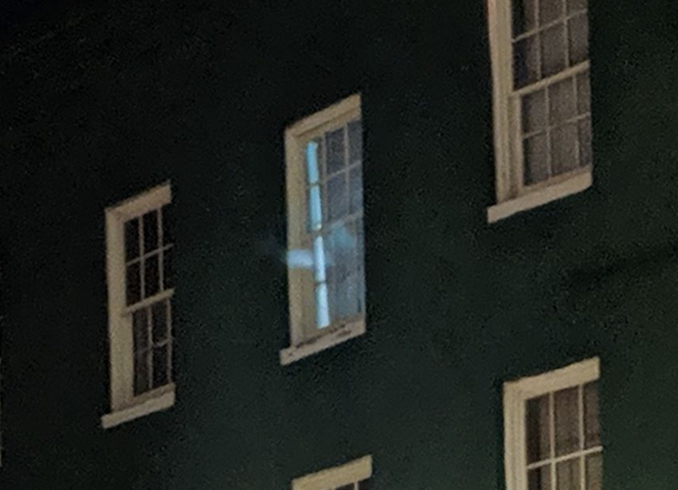 Close up of the ghost in the bar window.