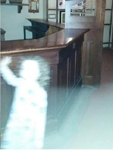 Eerie photo shows ghost child glowing in the foreground.