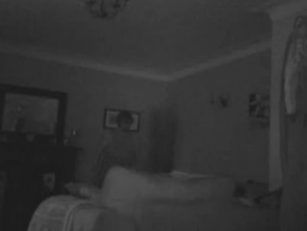 One of a few scary images that shows a possible intruder caught on security camera in a person's home.