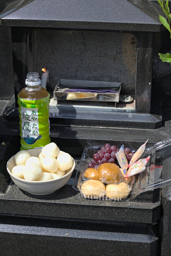 Food and drink offering on a grave.