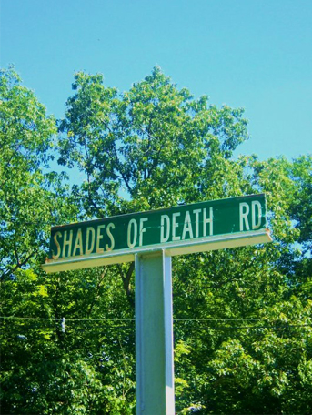 Photo of road sign 'Shades of Death Rd'. One of many bizarre mysteries.