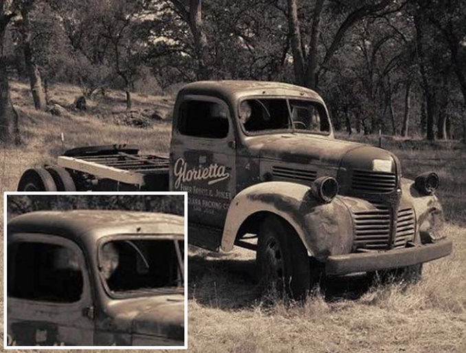 Black and white photo of old pick up truck, may show ghost inside.