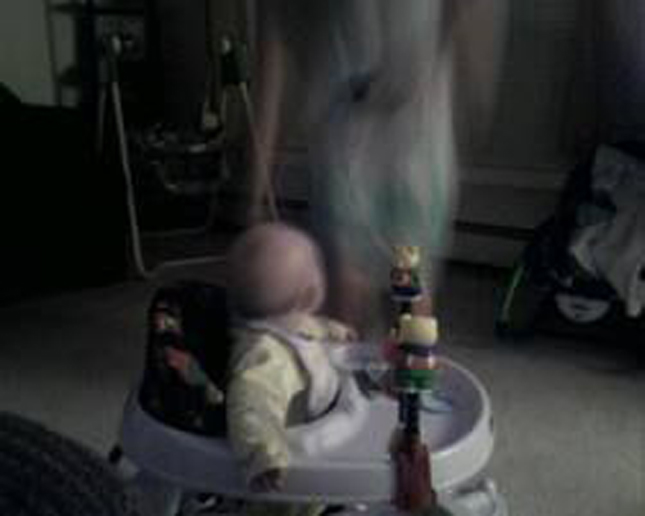 A toddler looking at a ghost.