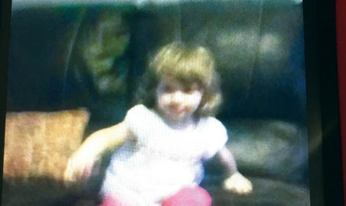 Creepy witch face appears in photo of young girl. Eerie ghost photos.