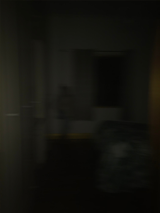 Photo of a ghostly figure in the darkness.